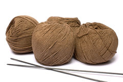 Yarn and spokes for knitting. On a white background it is isolated Royalty Free Stock Photo