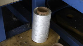 Yarn spools on spinning machine in a factory stock video