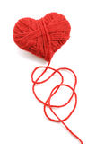 Yarn of wool in heart shape symbol. Red heart shape symbol made from wool isolated on white background Stock Images