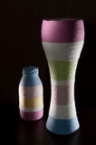 Yarn wrapped glass bottles Royalty Free Stock Photography