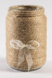 Yarn wrapped jar with a bow Royalty Free Stock Photography