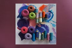 Yarns of threads for knitting in different colors on a palette. Background Royalty Free Stock Photography