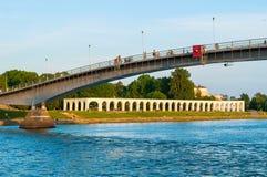 Yaroslav`s Courtyard and footbridge across Volkhov river at spring sunset in Veliky Novgorod, Russia. Stock Image
