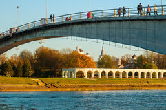 Yaroslav`s Courtyard and footbridge across Volkhov river in Veliky Novgorod, Russia. Royalty Free Stock Photography