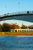 Yaroslav`s Courtyard and footbridge across Volkhov river in Veliky Novgorod, Russia. Stock Photography