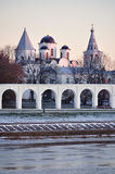 Yaroslav's Courtyard at winter sunset, Veliky Novgorod, Russia. Closeup of  Yaroslav's Courtyard churches and arcade of ancient arcade at winter sunset in Veliky Royalty Free Stock Photos