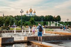 YAROSLAVL, RUSSIA - AUGUST 4, 2018: The arrow is the site of the founding of Yaroslavl. People relax at sunset on the banks of the. Volga. The confluence of two royalty free stock photography