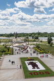 YAROSLAVL, RUSSIA - JUNE, 2015: Celebrations of 1005 anniversary of city foundation. Flowerbed on foreground represents city symbol. Monument of 1000-th Stock Photos