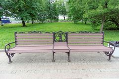 Yaroslavl, Russia. - June 3.2016. Public bench with a cast coat of arms of Yaroslavl on the embankment of the Volga near the gazeb. Yaroslavl, Russia. - June 3 royalty free stock photos