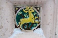 YAROSLAVL, RUSSIA - NOVEMBER 09, 2016: encaustic tiles. YAROSLAVL, RUSSIA - NOVEMBER 09, 2016: vintage tile depicts a yellow deer on a green background Stock Photo