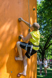 Yarych street Fest 2015. Children compete in climbing on an inflatable hill climbing to the top Royalty Free Stock Images