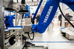 Yaskawa moto mini robot arm on Messe fair in Hannover, Germany Stock Photo