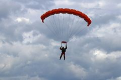 Yaslo, Poland - july 1 2018: The parachutist jumps with the parachute in difficult meteorological conditions. A shaving flight on stock photos