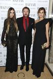 Yasmin Le Bon, Amber Le Bon. Amber Le Bon with parents, singer Simon and model Yasmin Le Bon arriving for the Harpers Bazaar Women of the Year Awards 2011 at Royalty Free Stock Photography