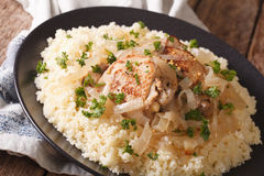 Yassa chicken stewed with marinated onions and couscous close up Royalty Free Stock Photography