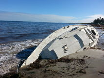 Yatch boat beached wrecked royalty free stock photos