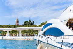 Yatch at the port of Malaga, with the Malaga's Cathedral in the background. Royalty Free Stock Image