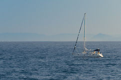 Yatch sailing in the Aegean Sea, Greece. A small boat cruising in the Aegean Sea of Greece stock photography