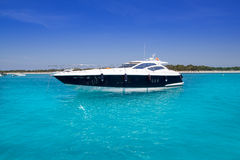 Yatch in turquoise beach of Formentera Royalty Free Stock Photos
