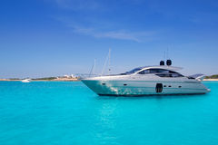 Yatch in turquoise beach of Formentera. Luxury yatch in turquoise beach of Formentera Illetes Royalty Free Stock Photos