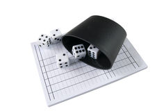 Yatzy block with dices. And throwing mug Royalty Free Stock Photo