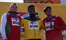 YAUHENI BAHUTSKI from Belarus, KAI CHANG from Jamaica, CLAUDIO ROMERO Chile Winners of discus throw in the IAAF World U20 Champ. TAMPERE, FINLAND, July 15 royalty free stock photography