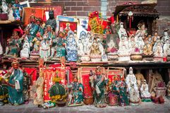 Large street shrine outside Tin Hau Temple on Temple Street, Hon. YAUMATEI, HONG KONG - MARCH 16, 2014 - Large street shrine outside Tin Hau Temple on Temple royalty free stock images