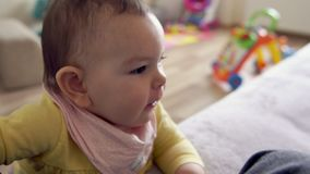 Yawing baby toddler indoors at home for day nap time. Yawing baby toddler indoors at home for day nap stock footage
