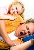 Yawn. Photo of tired man wanting to sleep and the girl lying on his shoulder Royalty Free Stock Photo