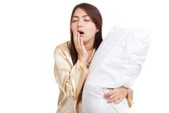 Yawn Asian girl  wake up  sleepy and drowsy with pillow Stock Image