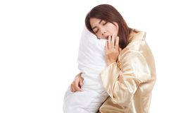 Yawn Asian girl  wake up  sleepy and drowsy with pillow Royalty Free Stock Photo