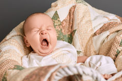 Yawn of an infant. Baby with mouth open. Facts about yawning royalty free stock photo