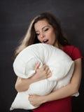 Yawn woman with pillow Stock Photos