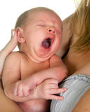 Yawning baby. 18 days old little baby yawning with wide open mouth Stock Photography