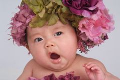 Yawning Baby. With a flower hat Stock Images