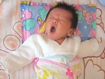 Yawning baby Stock Photos
