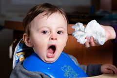 Yawning baby boy Stock Photos