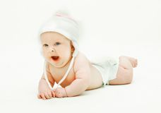 Yawning baby in hat. Over white Royalty Free Stock Photos