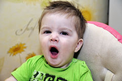 Yawning baby Stock Photography