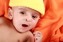 Yawning Baby with a Yellow Hat Stock Photography