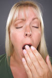 Yawning Blond Woman Stock Photos