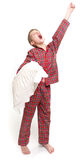 Yawning boy. In pyjamas holding a pillow Stock Images