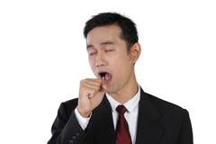 Yawning businessman, isolated on white Stock Photography