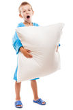 Yawning child boy holding pillow going to sleep. Little tired yawning child boy hand holding pillow going to sleep white isolated Royalty Free Stock Photos