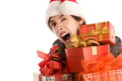 Yawning christmas boy holding gifts Stock Images