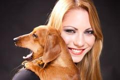 Yawning Cute Dachshund And Beautiful Woman Stock Photo