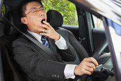 Yawning while driving Stock Image