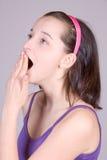 Yawning girl Stock Images