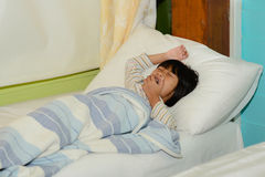 Yawning girl on bed. Stock Photos