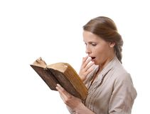 Yawning girl reading a boring book Royalty Free Stock Images